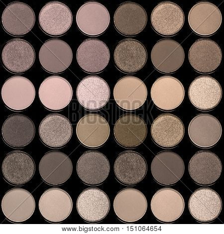 A seamless background palette of eyeshadows in smokey neutral tones.
