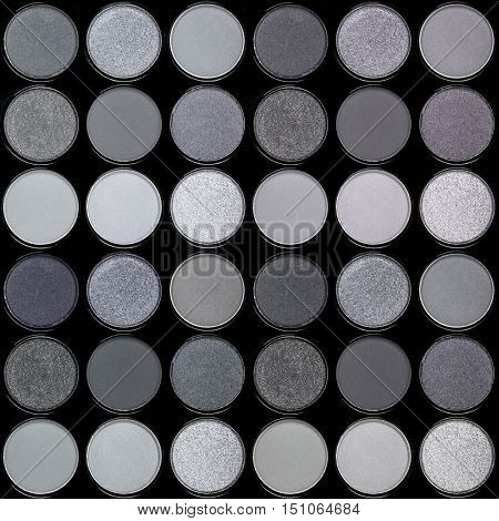 A seamless background palette of eyeshadows in smokey tones of silver and grey.
