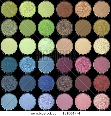 A seamless background palette of eyeshadows in tones of green, blue, purple, pink and brown.