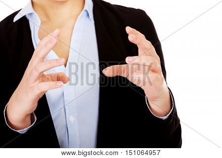 Business woman holding something or copyspase between two hands