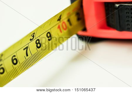 measuring on wooden table close-up, blurry background