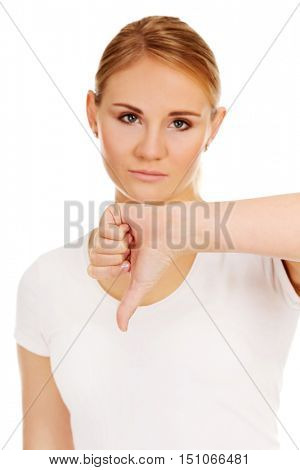 Young unhappy woman showing thumb down