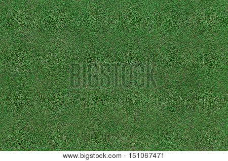 Green artificial grass texture as background detail