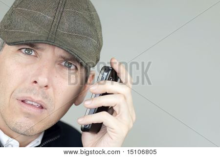Stressed Man In Newsboy Hat On Phone