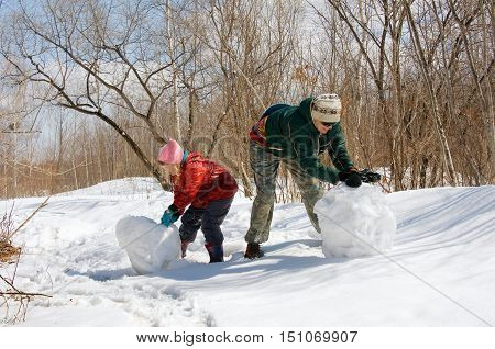 Mother And Daughter Ride A Snowball