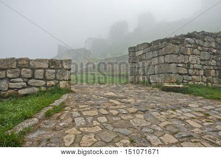 Old cobblestone path to Kalemegdan fortress covered in fog, Belgrade, Serbia