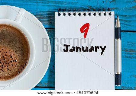 January 9th. Day 9 of month, calendar on freelancer workplace background. Winter concept. Empty space for text.