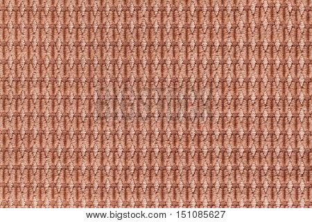 Brown background from soft fleecy fabric close up. Texture of textiles macro.