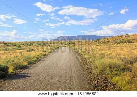 Adventure in African desert. Dirt mountain road in Karoo National Park, Western Cape, South Africa. Dry season. The parks of South Africa are famous for the magnificent scenery and wildlife.