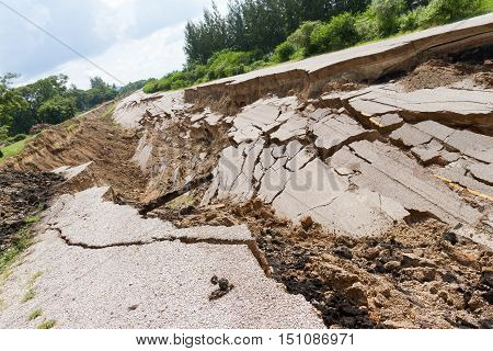 asphalt road collapsed and fallen since the ground collapsing.