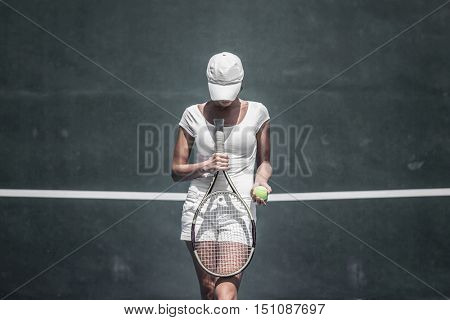 Female tennis player on court ready to play