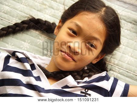 cute portrait Asian long hair pigtail young girl