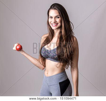 Latina woman exercising with a weight