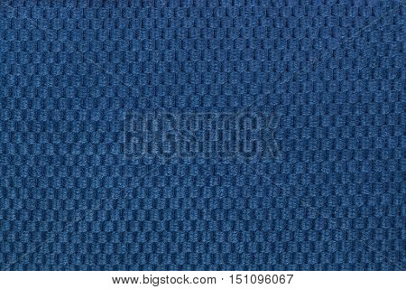 Dark blue background from soft fleecy fabric closeup. Texture of textile macro.