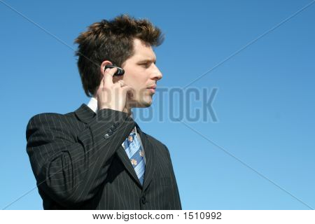 Businessman Using A Hands Free Device