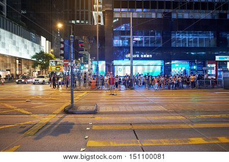 HONG KONG - OCTOBER 25, 2015: view of Hong Kong street at night. Hong Kong is an autonomous territory on the southern coast of China at the Pearl River Estuary and the South China Sea.