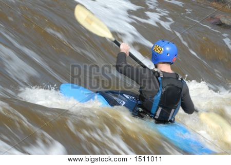 Blue Kayak  In Rapids