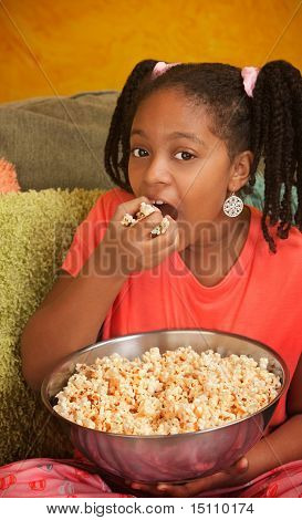 Little Girl Eats Popcorn