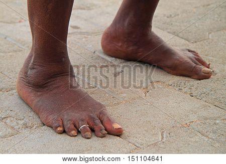 foot of old indian woman Kanyakumari southern India