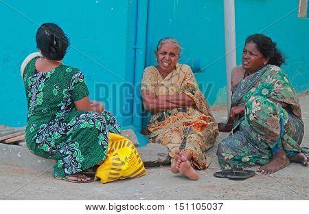 Three Women Are Sitting Outdoor In Kanyakumari, India