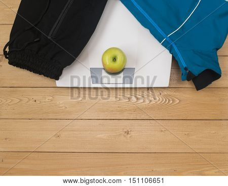 Sports Accessories For Fitness With An Apple And Scales.