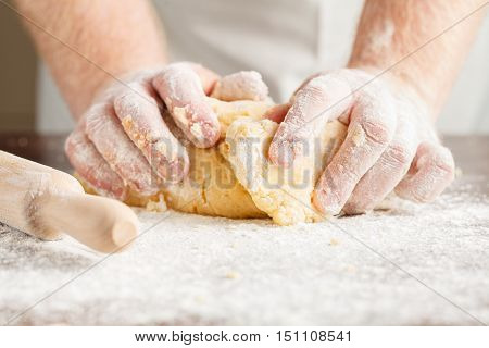 Closeup Photo Of Baker Making Yeast Dough For Bread.