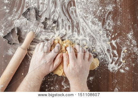 Hands Kneading Dough On Brown Wooden Table