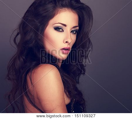 Beautiful Woman With Bright Smokey Makeup Eyes And Pink Lipstick. Volume Curly Hair Style On Grey Ba