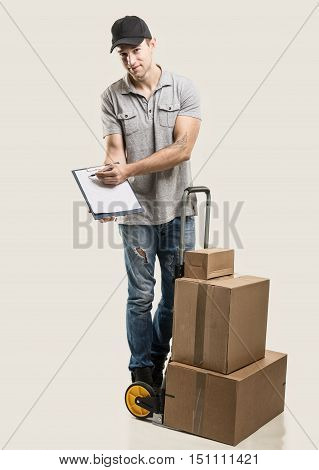 Courier hand truck boxes and packages on beige