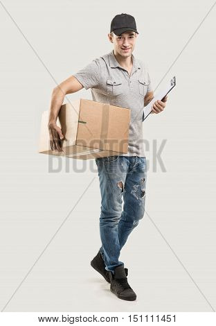 Courier hands of boxes packages on gray