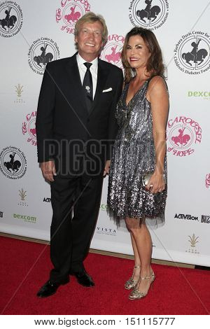 LOS ANGELES - OCT 8:  Nigel Lythgoe, wife at the 2016 Carousel Of Hope Ball at the Beverly Hilton Hotel on October 8, 2016 in Beverly Hills, CA