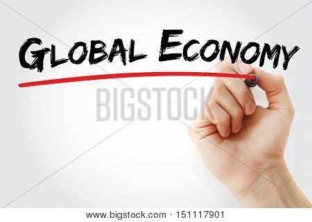 Hand Writing Global Economy With Marker