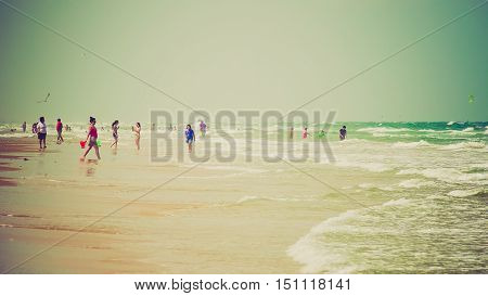 SOUTH PADRE ISLAND, TEXAS - APRIL 25: Beachgoers enjoying a Gulf of Mexico beach on South Padre Island on April 25th, 2016.