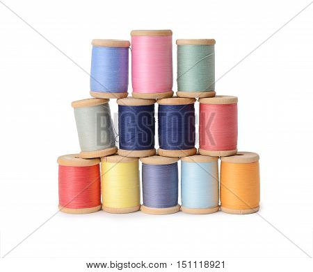 Plenty multicolor threads bobbins isolated on white background. Atelier, sewing accessories backdrop.