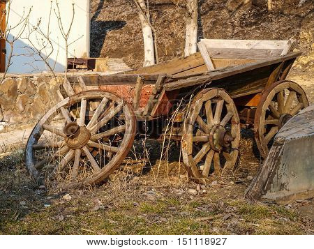 Old wagon and boat beautifully destroyed on the outskirts of the infield