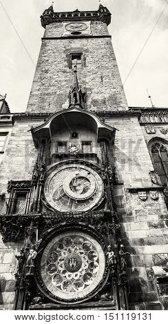 Old town hall with astronomical clock in Prague. Cultural heritage. Architectural theme. Vertical composition. Travel destination. Black and white photo.