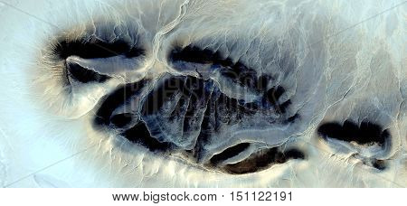 Allegory of fossil footprint alien in the African desert,photography of abstract landscapes of deserts of Africa from the air, Munimara Collection of Abstract Naturalism,forms of stone in the desert