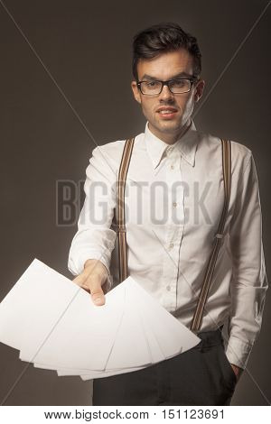Young businessman inviting you to subscribe a contract