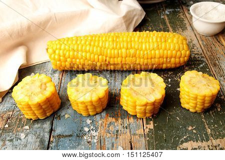 Boiled Corn And Chopped Corn Ear On Rustic Wooden Table