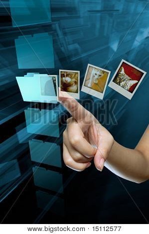 a woman hand choice a folder on a screen