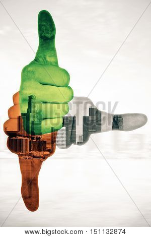 Three colorful hands showing thumbs up and pointing to different directions on abstract city background. Double exposure