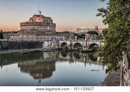 View of Castel Sant'Angelo and the bridge of the same name from the quay of the river Tiber in Rome italy
