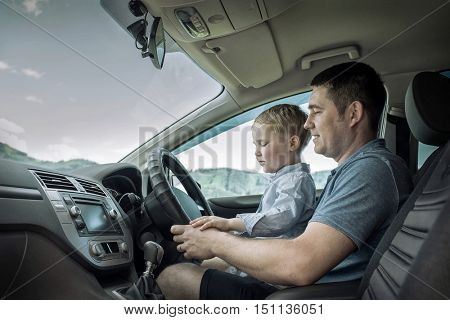 Father and son driving in car