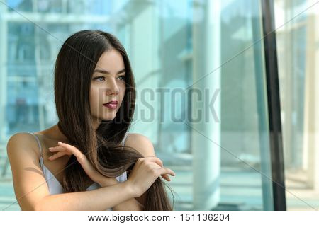Beautiful Girl Playing With Her Hair