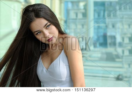 Hair Of Beautiful Girl Fluttering In The Wind