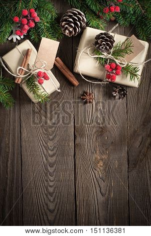 Packing Christmas gifts. Christmas gift boxes and decorations on wooden table. Top view with copy space