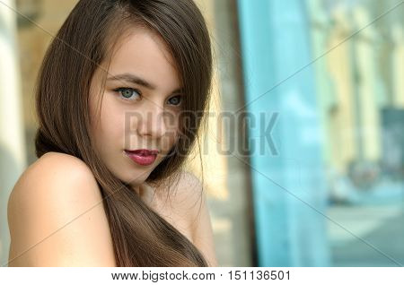 Portrait Of A Girl With A Piercing Gaze