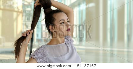 Girl Playing With Her Pigtail