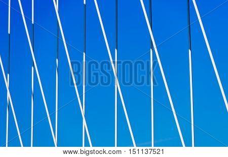 Bridge detail against clear summer sky - powerful iron holding bridge