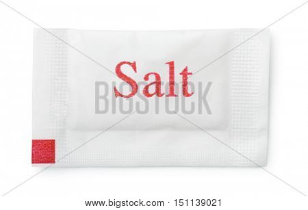 Top view of small paper salt sachet isolated on white